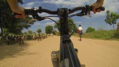 Tourist travel in asian rural road by mountain bike Stock Footage