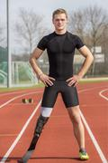 Handicapped sprinter standing track Stock Photos