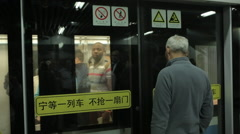 Opening doors in carriage Chinese subway Stock Footage