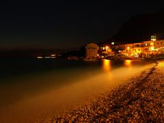 Night view to old beach in Croatia, vapor on water level donne by long exposure, - stock photo