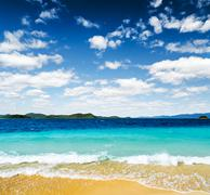 islands seen from the beach - stock photo