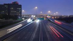 Time-lapse major interchange traffic at dusk. Dallas High 5 Stock Footage