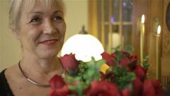 Happy woman receiving beautiful red roses on anniversary. Stock Footage