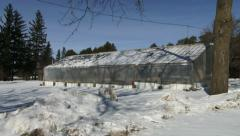 Small greenhouse in an organic farm in winter - stock footage