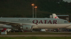 Qatar Airlines Airbus 330 taxiing after landing Stock Footage