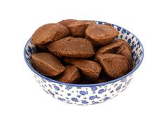 Brazil nuts in a blue and white china bowl Stock Photos