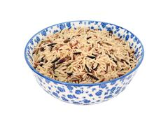 Mixed rice grains in a blue and white china bowl - stock photo