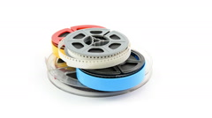 Ilm reels rotating on white background Stock Footage