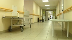 Hospital corridor with medical gurney Stock Footage