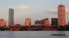 Boston Skyline Daytime Harvard Crew Team Rowing in River Stock Footage