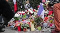 Lighting Candle Vigils at Charlie Hebdo Shooting Memorial Shrine Paris France Stock Footage