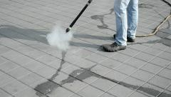 Cleaning of the street with hot steam technology, environment. Stock Footage