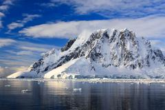 Snow-capped mountains in Antarctica - stock photo