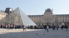 Stock Video Footage of Louvre Museum Glass Pyramid Crowd Daytime