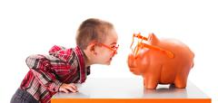 Stock Photo of Playing with Piggy Bank