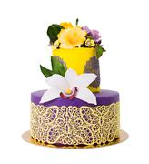Colorful cake decorated with candy flowers and lace - stock photo