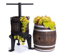 Grape pressing utensil and barrel with white grapes Stock Photos