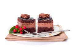 Stock Photo of Two chocolate layer mousse cake on plate