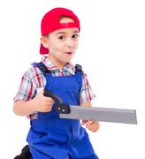 Little handyman showing saw cutting hazard Stock Photos
