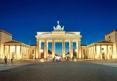 The illiminated Brandenburg Gate at dawn - stock photo