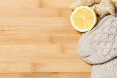 honey, lemon, ginger and mittens on a wooden background - stock photo