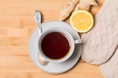 Cup of tea with honey,  ginger and lemon on wooden table - stock photo