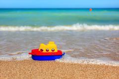 Little toy ship on beach Stock Photos