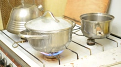 Food (rice) boiling over in stainless steel saucepan Stock Footage