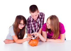 Three teens collecting money together Stock Photos