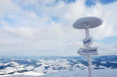 Frozen direction sign at Gimba mountain, winter time,Transcarpathians,Ukraine - stock photo