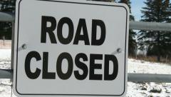 Sign indicating road closed for snow - stock footage