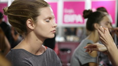 Fashion model prepares backstage Stock Footage