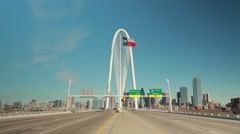 Dallas Skyline w/Margaret Hunt Hill Bridge & TimeLapse traffic whizzes by Stock Footage