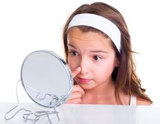 Girl searching for pimples - stock photo