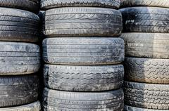 Stack of used tries that from truck and cars Stock Photos