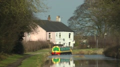 Pink canal cottage with barge Macclesfield canal rural setting Stock Footage