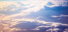 Sunrise above clouds - stock photo