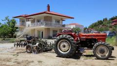 Wheel tractor near beautiful summer cottage Stock Footage