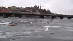 10s Traffic Across Icy River Stockholm Stock Footage
