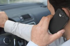 Phoning car driver - stock photo