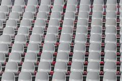 Stock Photo of Uniform grey seats