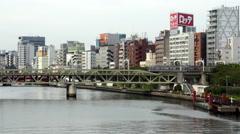 Time Lapse of Passenger Train Passing the Tokyo Skyline Daytime - Tokyo Japan Arkistovideo