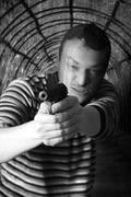 Black dressed man with gun Kuvituskuvat