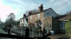 Lock keepers cottage on Macclesfield canal rural setting Stock Footage