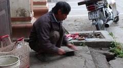 Farmer working knife sharpener Stock Footage