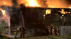 3 alarm fire lots of smoke and flames firefighters working - stock footage