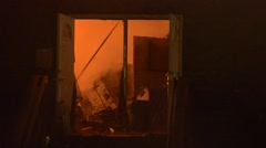 Commercial fire looking in the window flame glow Stock Footage