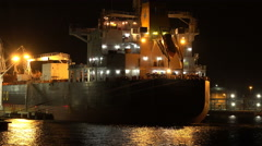 Sailing Past Cargo Ship A Port On Dark Night Close Up Stock Footage