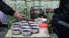 Asian farmers working in the kitchen, making traditional dishes Stock Footage