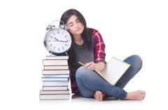 Young female student missing her deadlines on white Stock Photos